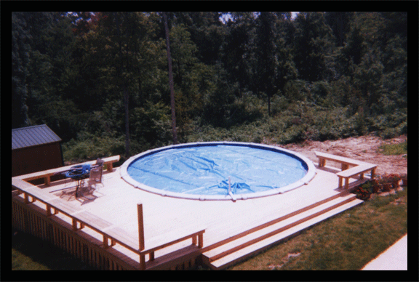 Building decks and fences around pool areas with bench seating for a nice area outside the pool.